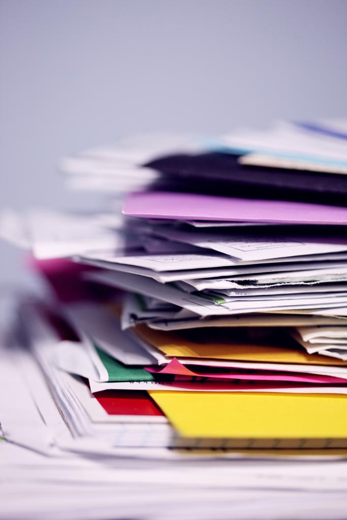 Photo of stack of mail by Sharon McCutcheon on Unsplash